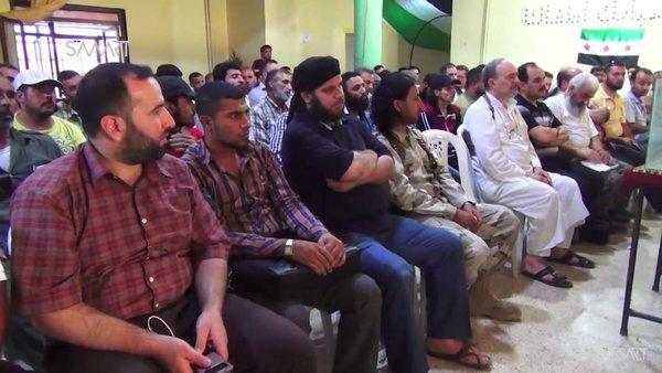 Члены Революционного совета Алеппо избирают городских служащих.